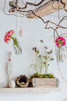 Ranunculus in suspended vases, Easter egg and fairy lights in dining room