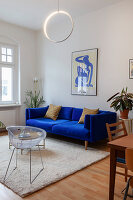 Royal-blue sofa, retro chair and coffee table in living room