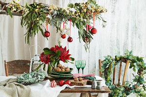 Leaf wreaths and branches decorated with leaf branches and balls as a Christmas decoration