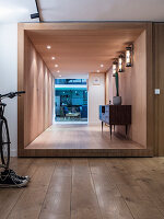 Sideboard and wood panelling in hallway