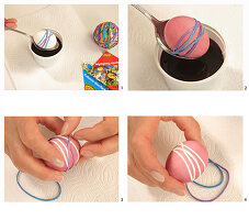 Dying Easter eggs using rubber bands to create stripes