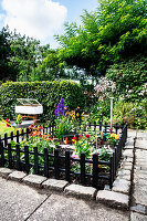 Eingezäunter Mini-Garten