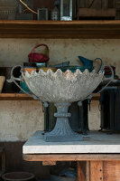 Antique planter on table in summerhouse