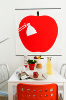 Picture of red apple above dining table in office