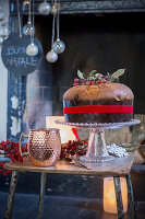 Panettone on table in front of festively decorated fireplace