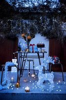 Terrace festively decorated with fairy lights and illuminated figures