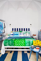 Mix of blue and green patterned textiles in bedroom