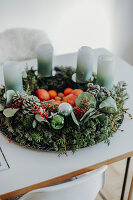 Modern Advent wreath with fruit in the centre and ombre candles