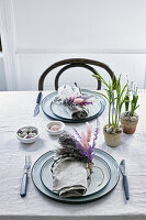 Napkin rings made from willow twigs and flowering grasses on Easter table