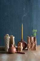 Extinguished candle and ornaments in earthy shades