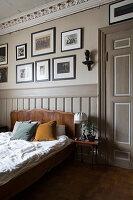 Panelled door, wainscoting and stucco ceiling in bedroom