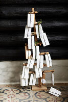 Numbered gift bags on stylised tree as Advent calendar