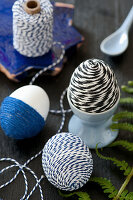 Easter eggs wrapped in twine