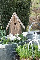Nesting box made from reclaimed wooden planks in zinc tub decorated for spring