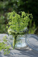 Posy of lady's mantle in preserving jar