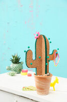 DIY cactus-shaped pin board