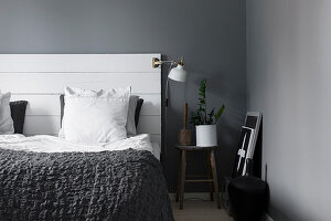 Bed headboard made from boards in grey and white bedroom