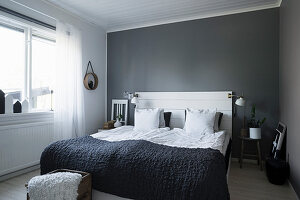 Simple bedroom in grey and white with board headboard
