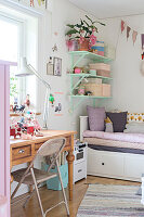 Old wooden table used as desk in vintage-style child's bedroom