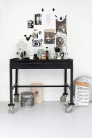 Gallery of pictures stuck on wall with washi tape above console table used as coffee station