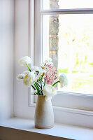 Ceramic vase of white ranunculus