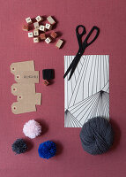 Gift wrapping materials and pompoms
