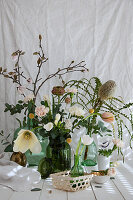 Spring bouquet of banksia, tulips, ranunculus, carnations, freesias, branches of magnolia and eucalyptus