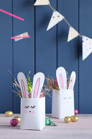 Handmade Easter nests with bunny motif made from recycled tetrapacks