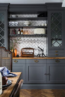 Classic, grey dresser with tiled back wall