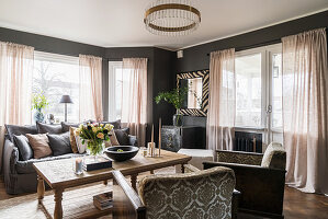 Classic living room in muted shades with grey walls