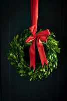 Christmas wreath of box leaves with red bow