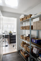 Basket on pantry shelves and view into kitchen