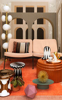 Side tables in front of two-seater sofa against mural wallpaper with architectural motif