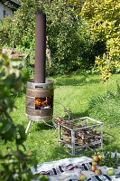 DIY stove made from metal barrel in garden