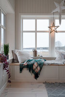 Cosy window seat on storage bench in winter
