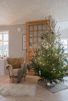 Simple Christmas tree in rustic living room