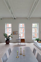 Pale dining table in loft apartment