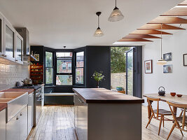 Classic kitchen-dining room with bay window and door leading into garden