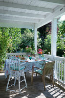 Dining table and chairs on roofed veranda