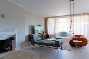 Chaise longue, suede sofa and TV cabinet in elegant living room