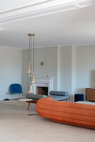 Chaise longue, suede sofa and fireplace in elegant living room