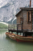 Boathouse and boats on Lake Prags, South Tyrol, Italy