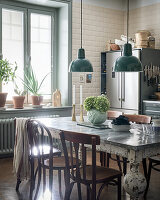Antique table and chairs next to window in kitchen