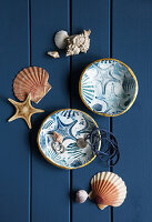 Cold porcelain dishes with maritime motifs
