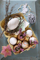 Romantic Easter arrangement with heather and eggs in egg box