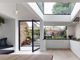 Multi-storey architect-designed house with swivelling terrace doors