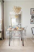 DIY table and acrylic glass chairs in dining area