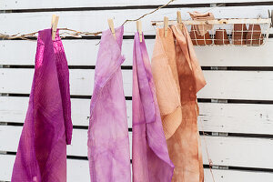 Fabrics coloured using natural dyes and hung up to dry