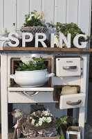 Spring arrangements in an old kitchen range