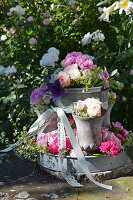 Roses and ribbon on handmade plant stand